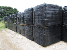 Sawdust bales are wrapped and can be stored outside without any water penetrating the bales