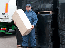 Sawdust bales are a convenient shape, size and weight making them easy to handle and pour.